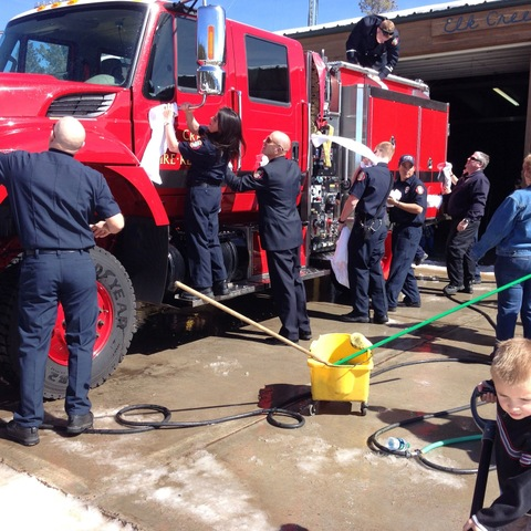 elk creek firefighters cleaning engine