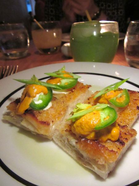 Uni toast with Robiolina cheese and tomato butter. The menu collects New Yorkers' favorites.