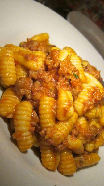 "Sardinian ""maloreddus alla campidanese"" with sausage in a spicy tomato sauce."