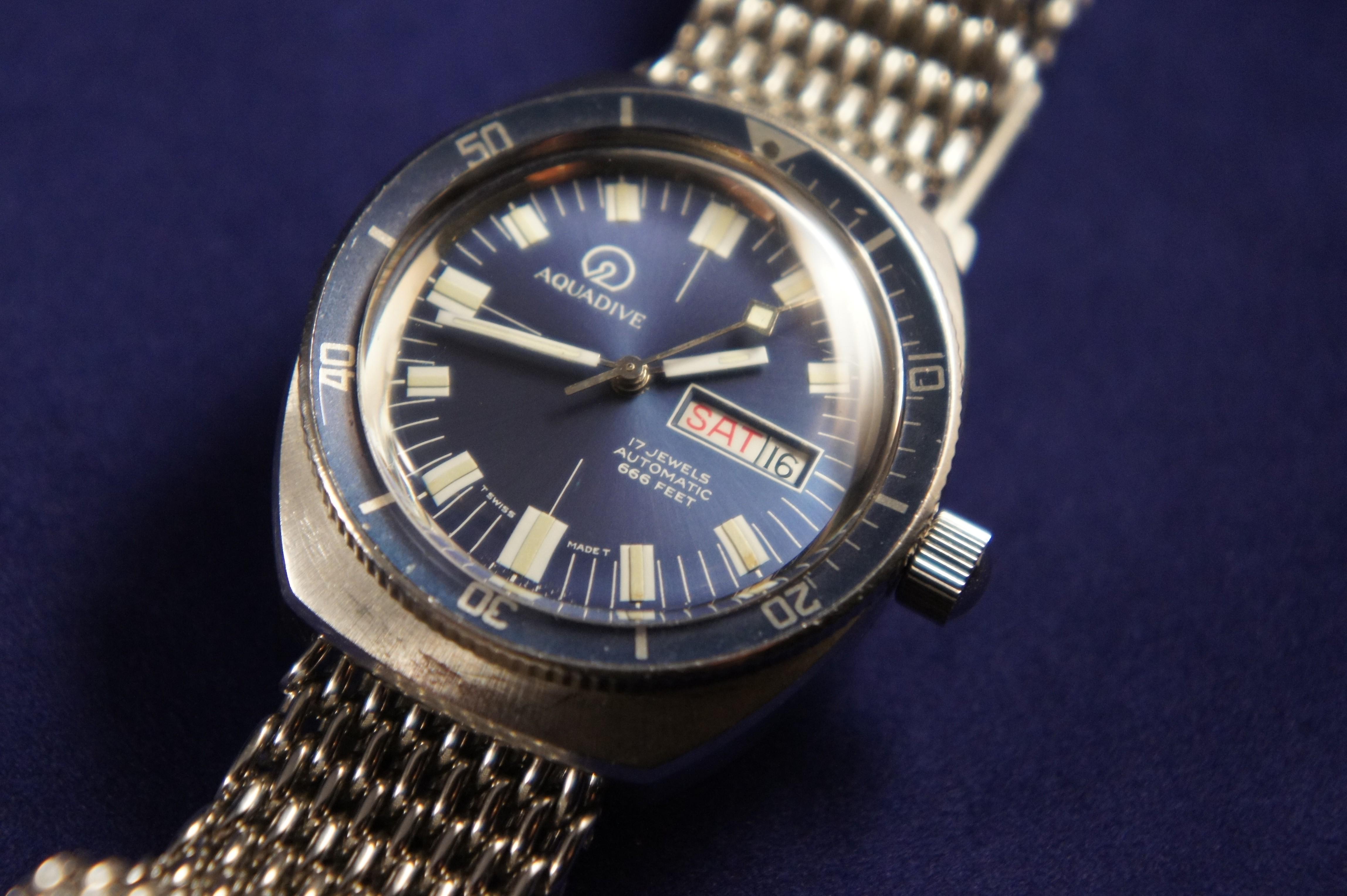 Sold '70s Vintage Aquadive 200m Blue Diver. Horizontal Cross Bracelet. Diamond Cut Bangles. Cubic Zirconia Rings. Lapis Lazuli Pendant. Peacock Pearls. Cocktail Ring Diamond. Brain Cancer Bracelet. Charm Pendant