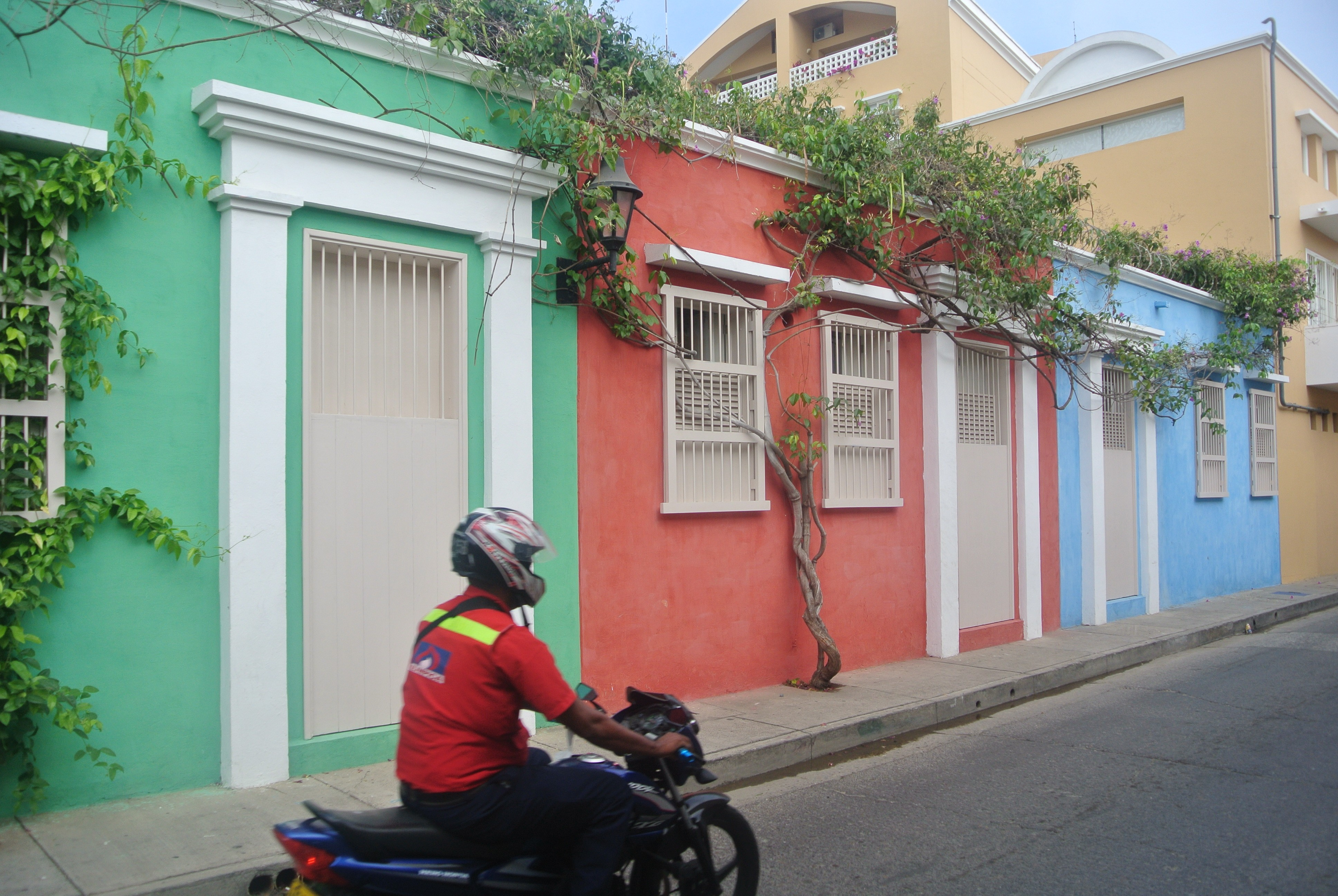 Getsemaní, Cartagena. Pastel Colour Houses with moto in foreground.