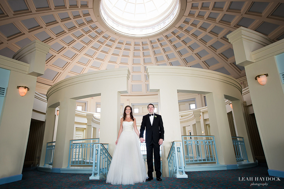 Bride and Groom holding hands in Rotunda at Boston Harbor Hotel