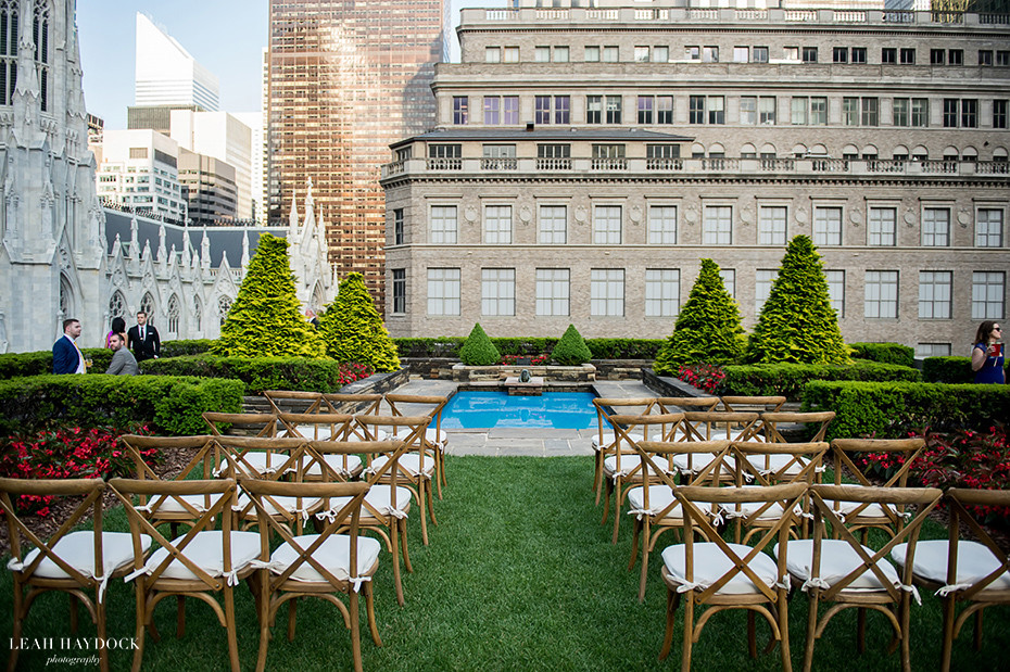 rooftop wedding venue at rockefeller center, ceremony chairs with pool