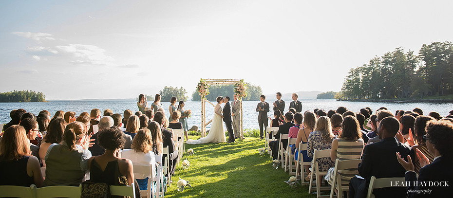 Migis Lodge Wedding Ceremony on Petunia Lawn with bride and groom kissing