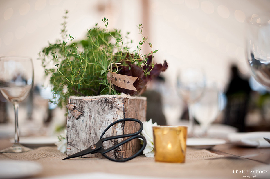 Herb wedding centerpiece with antique gardening scissors