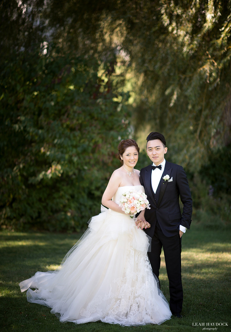 Bride in Vera Wang Wedding Dress standing with Groom