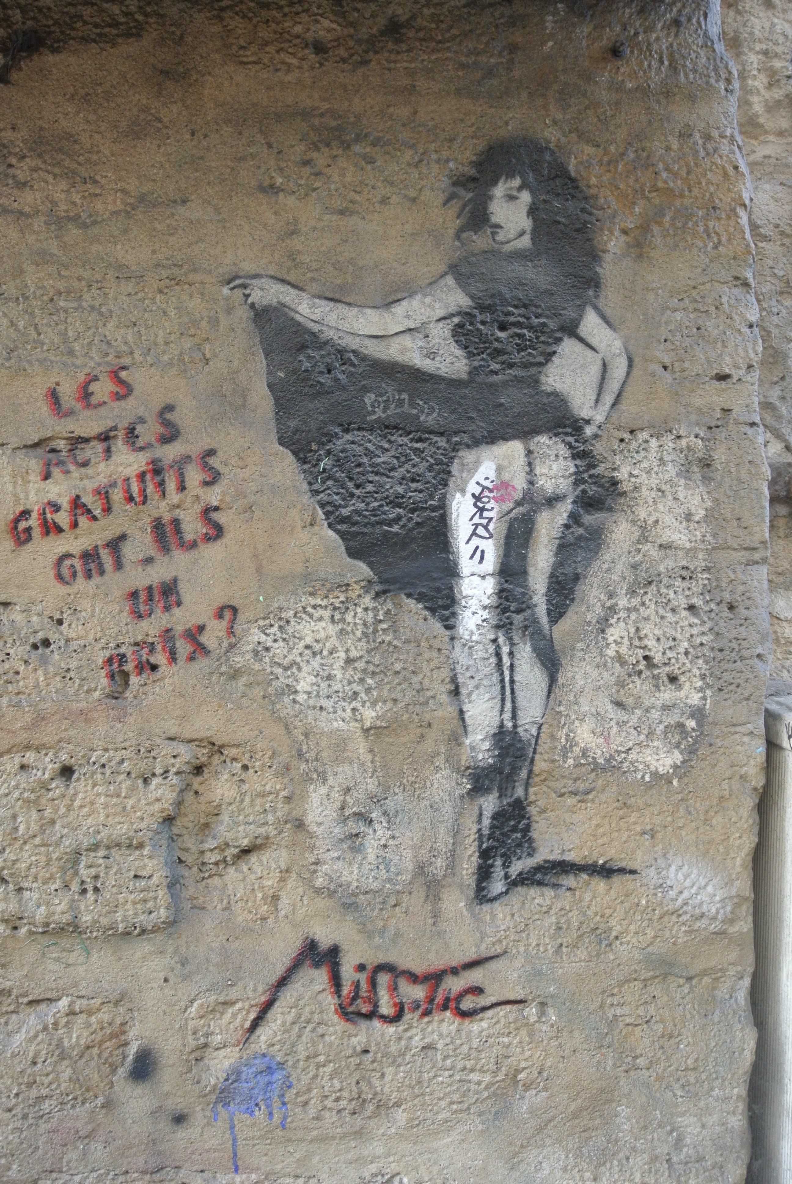 """Miss Tic """"Les Actes Gratuits, ont-ils un prix?"""" street on Rue Mouffetard, 6th Arrondissement, Paris"""