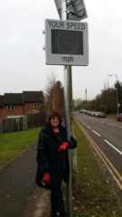 Judi with one of the new speed signs on St Michaels Road