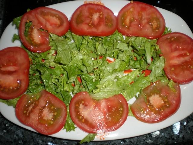 Poner el tomate