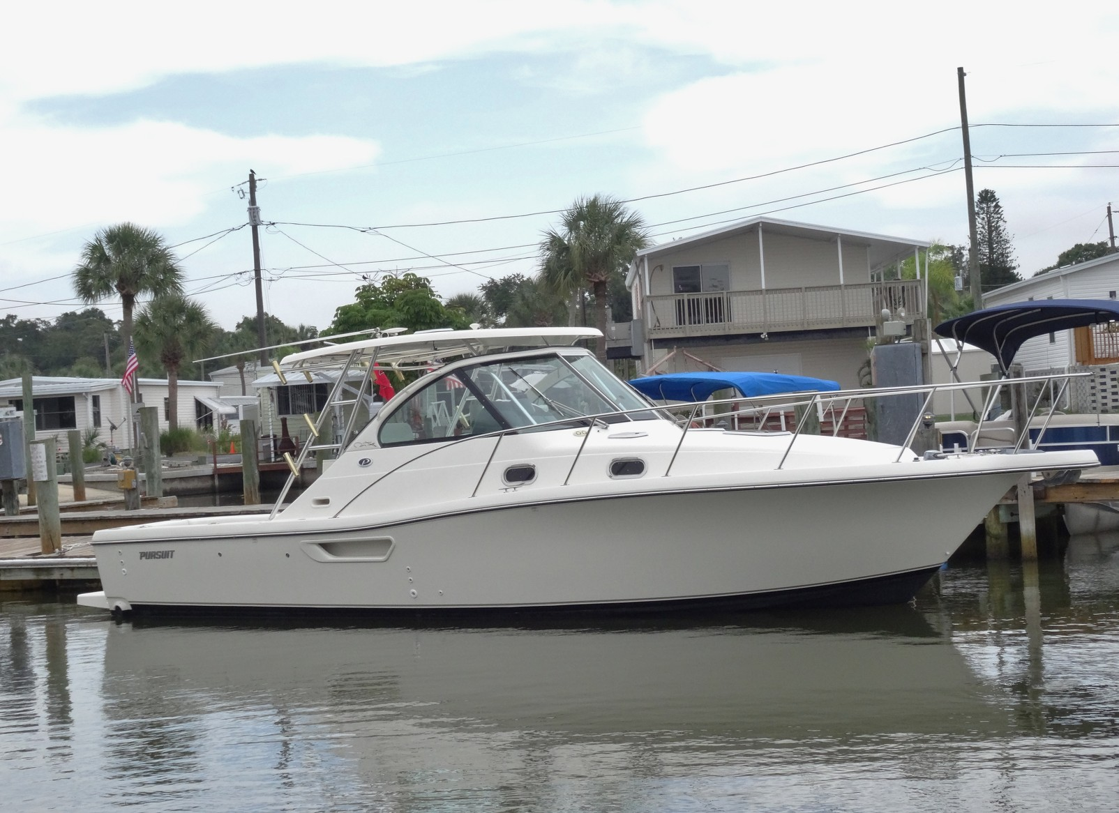 Wholesaleingfla pursuit 3100 offshore walk around cuddy for Off shore fishing boats