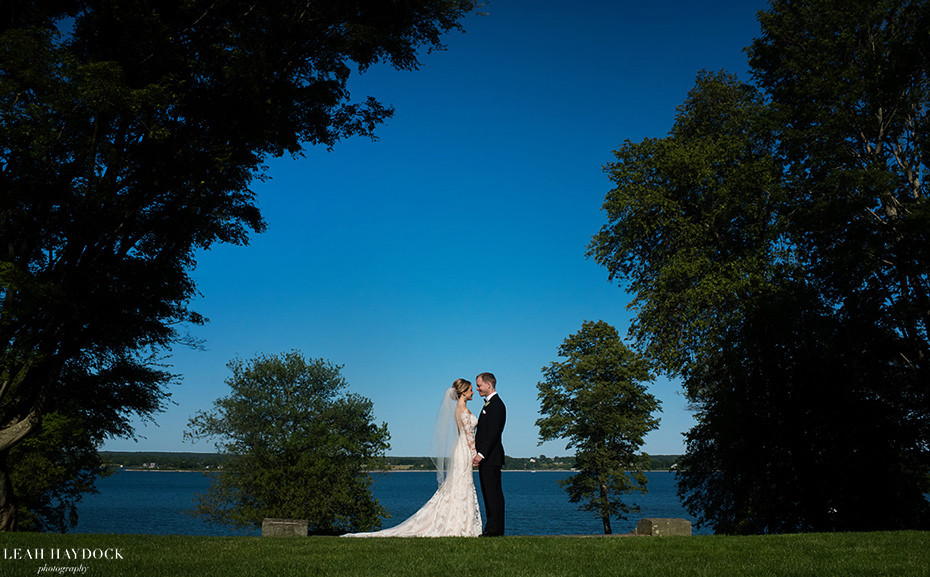 Bride and groom overlooking the ocean at a Glen Manor House wedding in Portsmouth RI